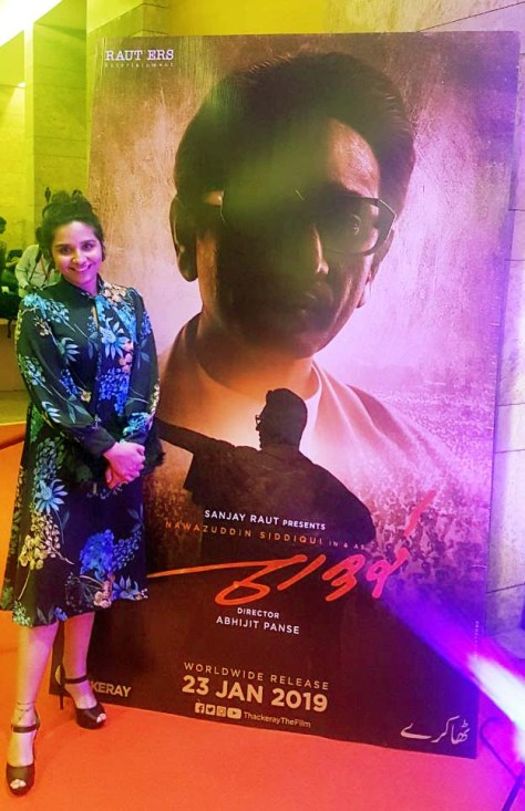 Preetisheel Singh besides a poster of Thackeray